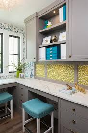 gray blue and green home office space features an l shaped gray desk with brass knobs topped with a white marble countertop seats blue sawhorse desk blue home office
