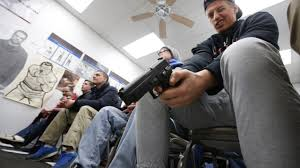 gun culture and the american nightmare of violence com jaden adams person look over a unloaded semi automatic handgun during a packed class to obtain the utah concealed gun carry permit at range master of utah