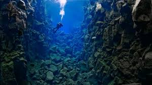 Image result for towering mountains and deep trenches in the depths of the sea.