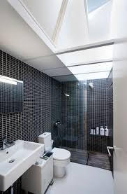 white bathroom floor: luxurious reformed home with wooden flooring minimalist black pixeled wall white floor bathroom