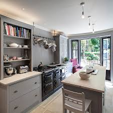 mixed cabinet styles coupled with open gray shelves give the kitchen a modern appeal design architecture kitchen decorations delightful pendant kitchen