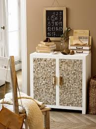 wooden furniture painted white whose doors are covered with bark tile and handles are birch branches bark furniture