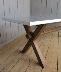 images zinc table top: side view of the cross base bespoke table with matt zinc table top