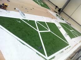 bespoke fake grass logo corporate event artificial grass london arttra artificial grass spider web