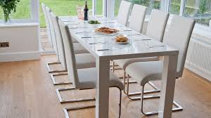dining table that seats 10: large extending white gloss dining table and dining chairs