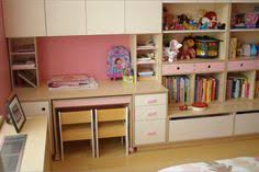 casa kids table with rollers fits under desk and can be stored or brought to calm casa kids