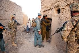 u s department of defense photo essay an afghan policeman asks the owner of a barn to unlock the door so that he