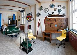 vintage bedroom with green classic car bed and automotive wall decorations and wooden desk car themed bedroom furniture