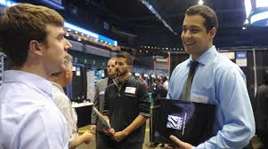 career fairs umass lowell a student interacts employers at the career co op center s career fair at