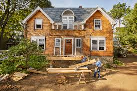 This Old House Projects   This Old HouseThis Old House Projects Remodels  Tom Silva and Kevin O    Connor moving a wood board to frame the deck for