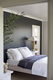 bedroom paneling ideas: dark painted wood paneling accent wall