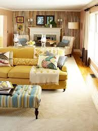 mustard yellow and cool blue are a gorgeous color scheme in this rustic living room bhg living rooms yellow