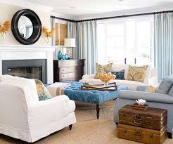 there are definitely some traditional touches in this living room featured at better homes gardens like the damask print denim cocktail ottoman bhg living rooms yellow