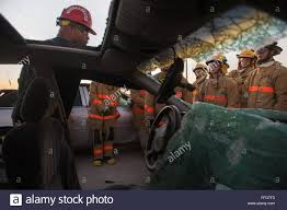 omar moore th training squadron goodfellow air force base goodfellow air force base texas explains vehicle extraction to student fire fighters at the department of defense louis f garland fire academy
