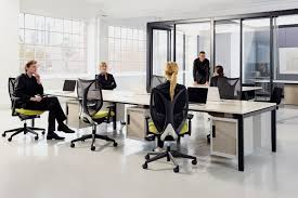 office define. and adjusting to the different temperatures of activity that define modern office hot tech touchdown spaces traditional settings