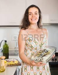 home kitchen faw kitchenjpg girdle woman happy girl preparing raw fish on roasting pan at home kit