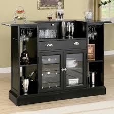 rear view of home bar with extensive storage and glass faced cabinets black mini bar