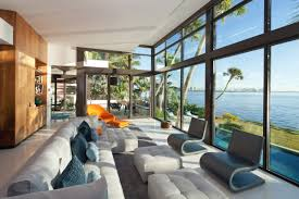 living room furniture miami: sofas living room glass walls waterfront residence in coral gables miami