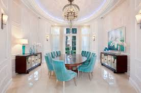 this classical room design is elegant but its not just the blue suede furniture or the chandelier that contributes to this elegant look enter the mirrored architectural mirrored furniture design