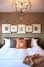 transform your favorite spot with these 20 stunning bedroom wall decor ideas hanging frames above bedroom sweat modern bed home office room