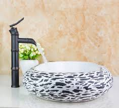 bathroom countertop basins wholesale: td  contemporary countertop oval ceramic wash artistic basin with oil rubbed bronze faucet set