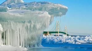Glittering <b>blue ice</b> draws many to Michigan's Straits of Mackinac