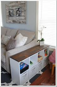 storage solutions living room: quick and easy kid storage great idea since we will need the room in the living