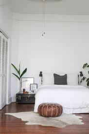 feminine bedroom furniture bed: white space wood and plants  white space wood and plants
