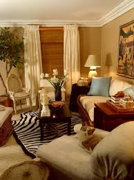 living room creamy warm cafe latte walls sisal carpeting under a zebra skin rug and lots of crisp bleached belgian linen on casual rattan furniture casual living room lots