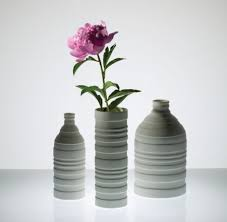 the niche groove vases are a fresh take on traditional forms they are not only axia modern lighting