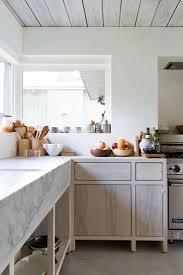 kitchen island integrated handles arthena varenna: rustic renovation celebrates minimalism in canada http freshomecom rustic