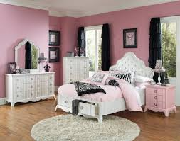 beauteous pink accent wall color scheme of teenage girls bedroom with white lacquered wooden bed frame which has cool upholstered tufted headboard and beauteous pink blue