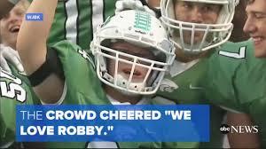 high school football com robby heil a senior at novi high school down syndrome cheers along