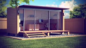 breathtaking garden design implemented with big prefab home office which has transparent sliding door wall and have stones low floor ground backyard office prefab