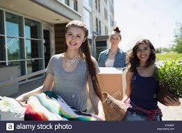 college students moving into college dorm stock photo royalty college students moving into college dorm