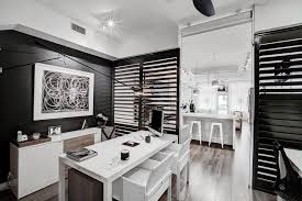 modern office look plantation shutters by casa resort trendy study room photo with black walls black white home office study