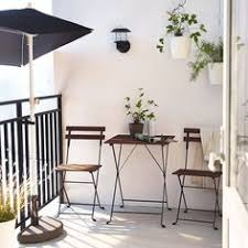 cheap minimalist outdoor seating for dining but not for lounging a balcony with balcony furnished small foldable