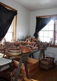 in an area of the home close to windows for natural light sit many baskets amish country kitchen light