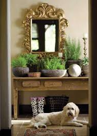 ornate mirror with farm house style table brighten dark room