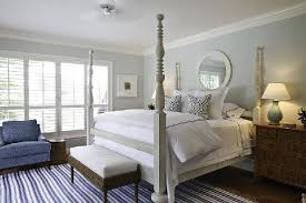 gray poster bed striped blue rug nightstands mirror and soft blue green walls paint color blue grey paint colors view