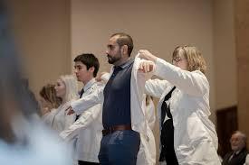 In 50th anniversary year, School of <b>Nursing</b> holds first <b>White Coat</b> ...