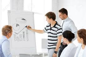 smiling business team working flipchart in office stock photo stock photo smiling business team working flipchart in office