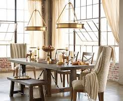 a duo of pendant lighting is twice as nice in this loft dining room breakfast room lighting