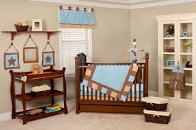 baby boy nursery room installed with baby storage furniture wall shelve placed above cute hanging ornaments adorable nursery furniture