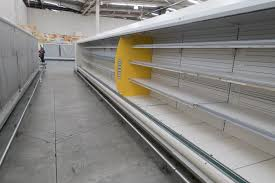 photos venezuelans contend food medicine shortages as low empty refrigerator shelves are pictured at a makro supermarket in caracas venezuela 4
