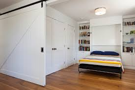 peninsula ranch inspiration for a contemporary guest bedroom remodel in san francisco with white walls and alluring murphy bed desk