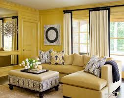 beige sectional living room sofa set with pillows and blanket also large wall mirror decor and beige sectional living room
