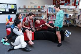 poor literacy and numeracy skills limit job chances a group of children look at library books