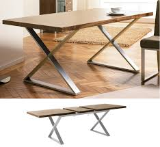 cream compact extending dining table: dwell crossed leg walnut extendable dining table