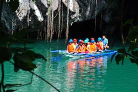 group of tourists in underground river in palawan
